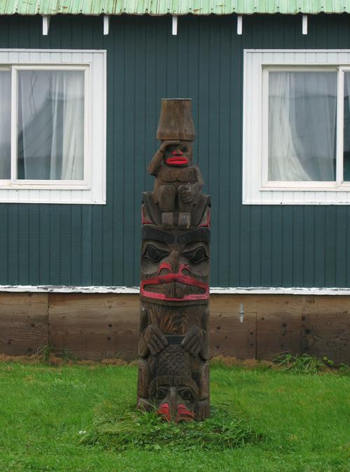 wet totem in front of Claude Morrison's house, Hydaburg, Alaska