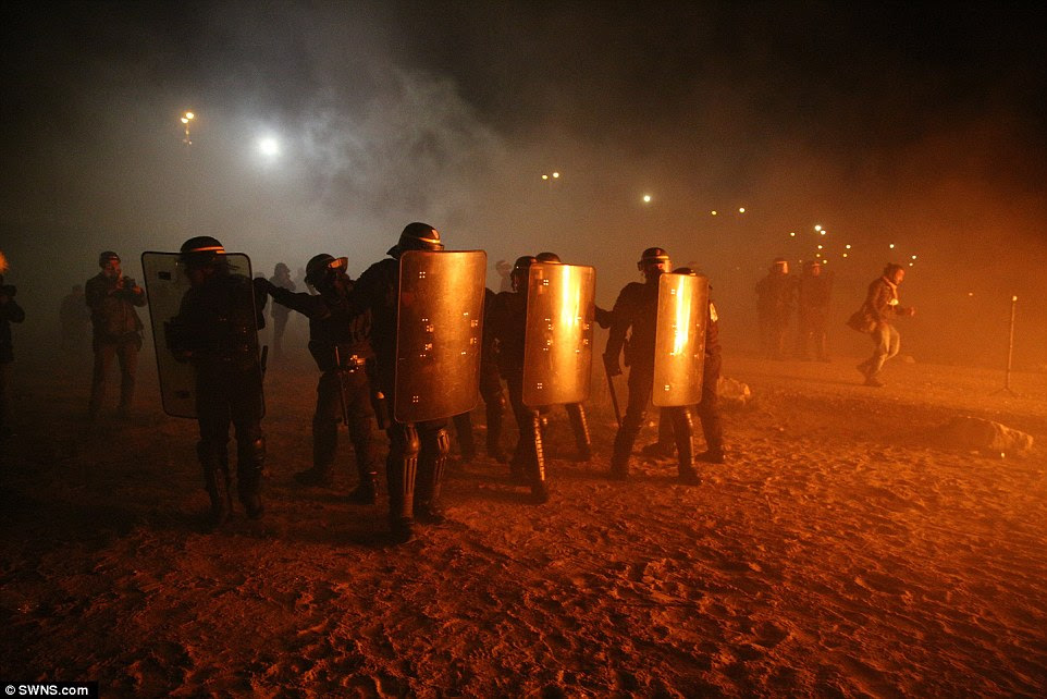 Police were seen at the camp wearing full riot gear, amid fears that anarchists have infiltrated the Jungle and plan to spark violence