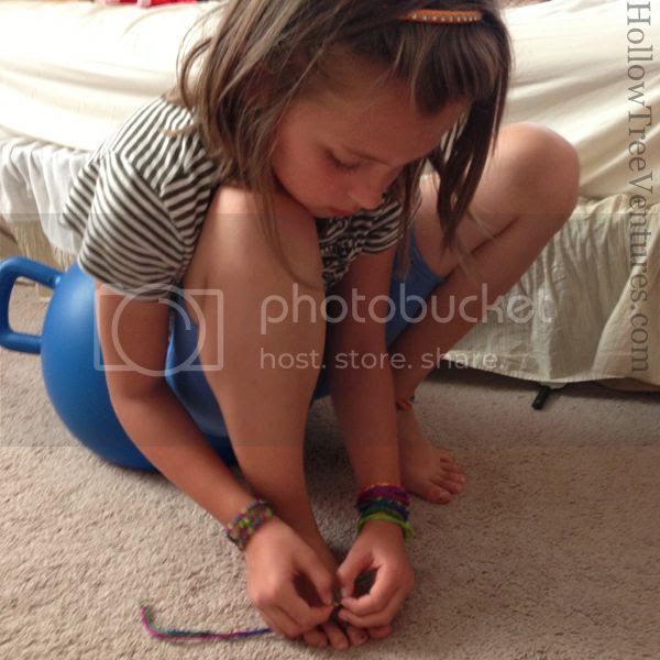 tying friendship bracelets