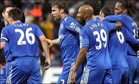 Chelsea celebrate their third goal at Bolton
