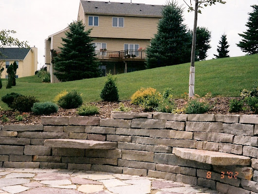 Large Stone Retaining Wall with Patio and Sitting Stones | Oasis Landscapes | West Fargo | Fargo | Moorhead