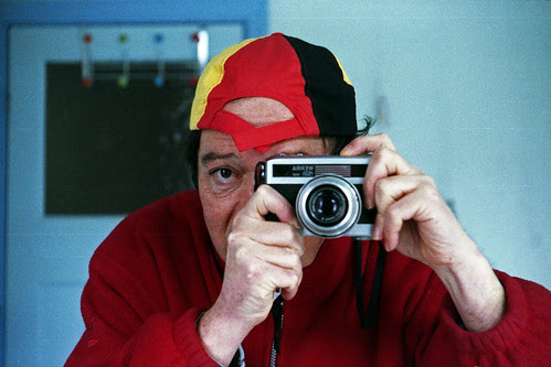 reflected self-portrait with Werramat camera and back-to-front German hat by pho-Tony