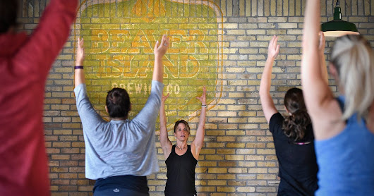 Class pairs Beaver Island beer tasting with yoga poses