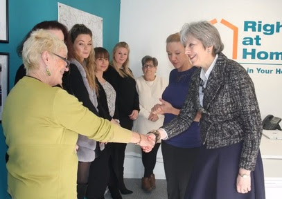 Theresa May takes break from Putin and Brexit to talk with home care workers