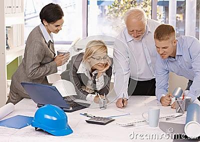 Cheerful Designer Team At Work