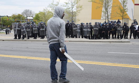 State of emergency and curfew in Baltimore as protests turn into riots | US news | The Guardian