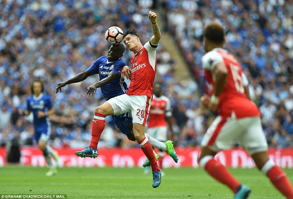 Chelsea's N'Golo Kante (left) goes up for a header with Arsenal's Granit Xhaka (No 29) during the first period