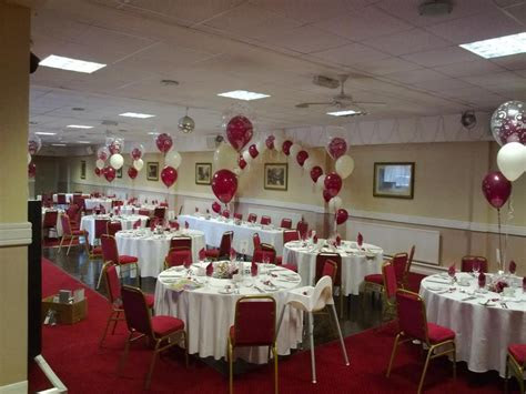 Beautiful top table arch and 3 balloon centrepieces