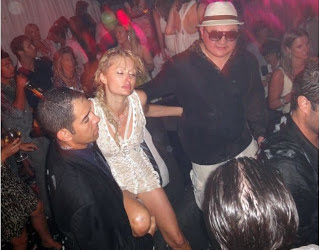 Paris Hilton after an excess of Cristal Champagne provided in yet another marathon session financed by Jho Low in the South of France 2010