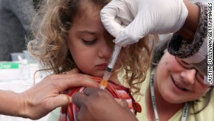 How countries around the world try to encourage vaccination