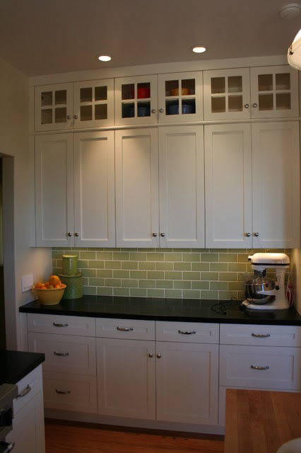 Glass doors on top lighten the bank of cabinets without ...