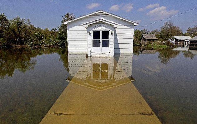 The Stumpy Point Congregational Holiness Church is shown surrounded by water following the effects of Hurricane Irene in Stumpy Point, N.C., Sunday, Aug. 28, 2011. The storm that spent 12-hours scouri