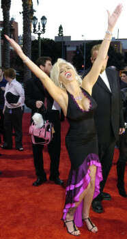 Smith arrives for the 32nd annual American Music Awards in Los Angeles in 2004. Photo: CHRIS PIZZELLO, Associated Press