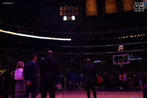From right to left: Kobe Bryant, Magic Johnson, Kobe's former agent (and now Lakers general manager) Rob Pelinka and Jeanie Buss watch as Bryant's two jersey numbers are retired during a halftime ceremony at STAPLES Center...on December 18, 2017.