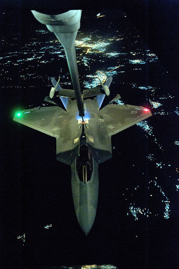 An F-22 Raptor gets refueled in mid-flight by a KC-10 Extender prior to conducting a combat sortie in Syria, on September 26, 2014.
