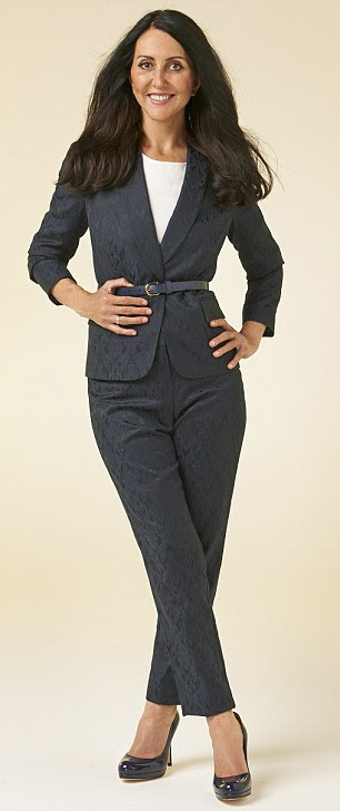 Blue and black Jacquard trousers, £59, matching blazer, £99, and navy snakeskin belt, £25, Collection by John Lewis. Ivory sculptured top, £75, Whistles. Navy court shoes, £195, LK Bennett