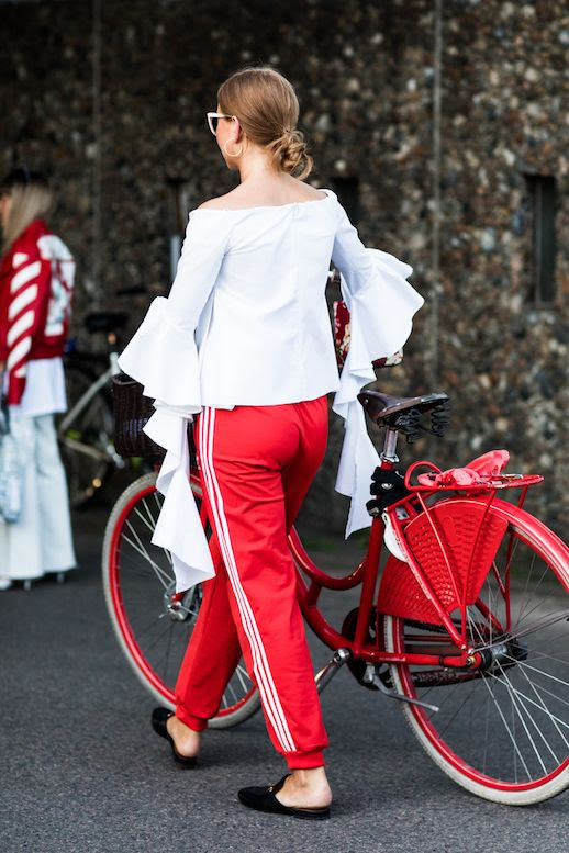 Le Fashion Blog Athleisure Statement Sleeve White Blouse Red Track Pants Flat Shoes Via Sandra Semburg