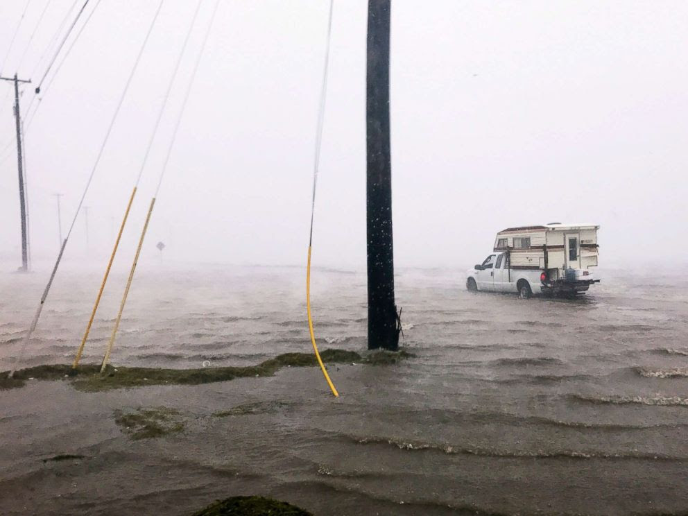 PHOTO: Craig Cajun Uggen, 57, nearly floods his truck as Hurricane Harvey comes ashore in Corpus Christi, Texas, Aug. 25, 2017.