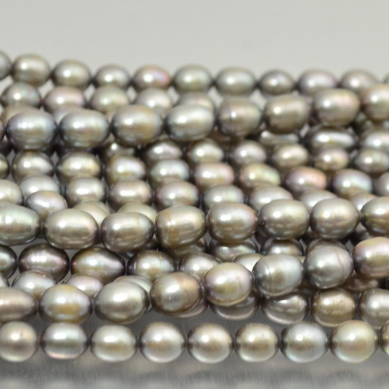 s16738 Freshwater Pearls - 6 x 7 mm Oval Pearl - Platinum Pearl (strand)