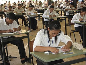 Young Cambodians doing an exam to be admitted ...