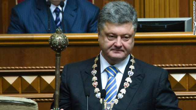 Poroshenko holds the bulava, the ceremonial mace of the President of Ukraine, during his inauguration ceremony Saturday, June 7, in Kiev, Ukraine. Poroshenko was elected three months after the ouster of former President Viktor Yanukovych.