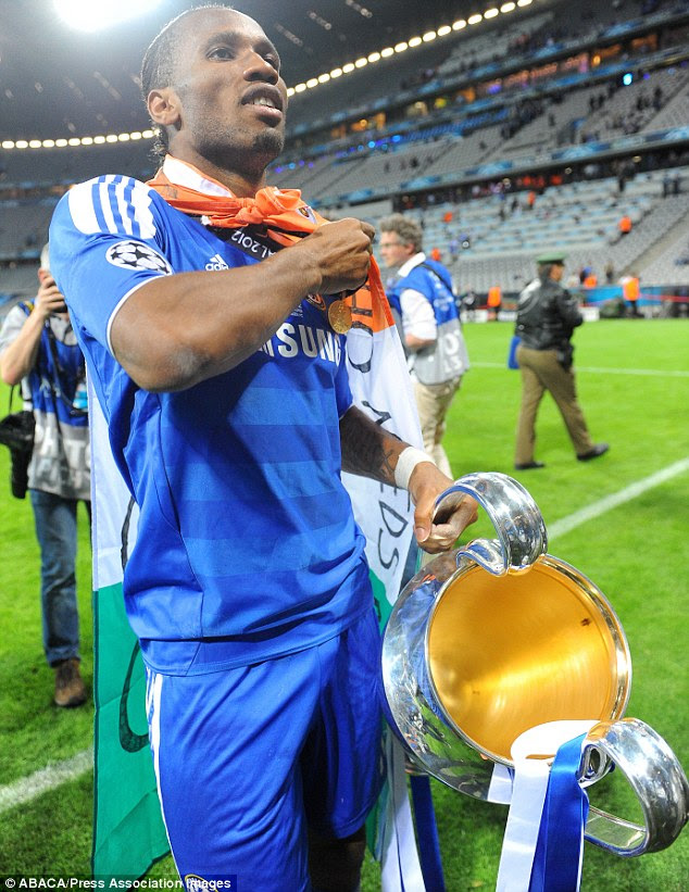 High: Drogba left on a high after helping Chelsea become the first London team to win the Champions League