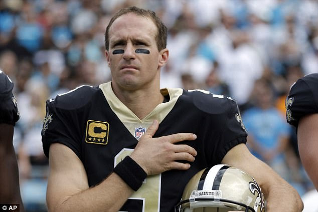 Saints quarterback Drew Brees stood for Sunday's national anthem in Charlotte while 10 teammates decided to remain on the bench in protest of police brutality against minorities