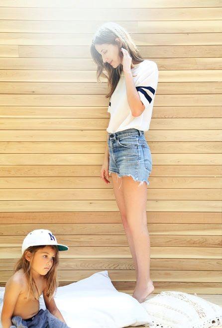 Le Fashion Blog Hannah Henderson Varsity Striped Sleeve Tee Vintage Denim Cut Offs Shorts Stylish Mom Son LA Style Via The Glow