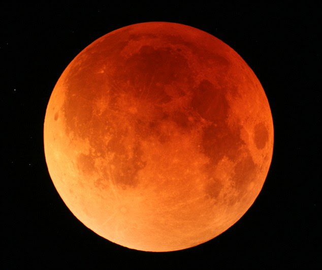 A total lunar eclipse in Japan, 2007: During totality light only reaches the moon through Earth's atmosphere, back-scattering blue light and making it appear red