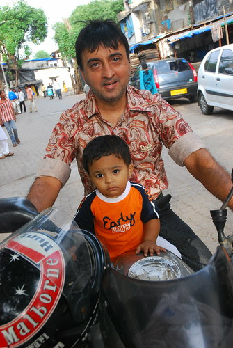 Raju Shresta And His Son At Bandra Bazar Road by firoze shakir photographerno1