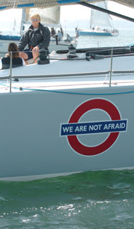 Nokia Enigma Class Zero yacht with stickers supporting the We Are Not Afraid campaign
