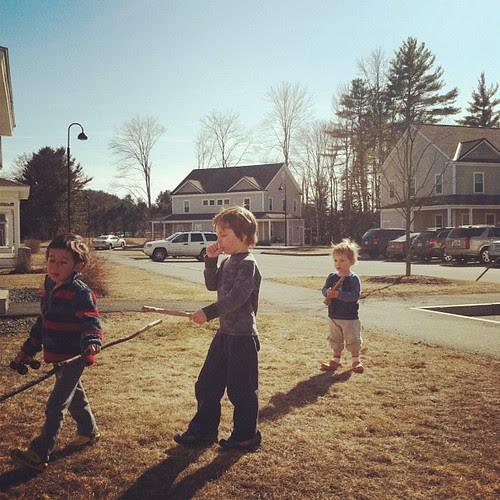 Three boys and their sticks.