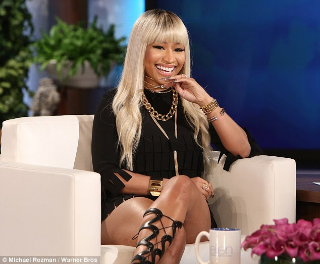 Bejeweled: Nicki Minaj sat down to talk with Ellen DeGeneres for Thursday's show wearing a black fringed ensemble with statement gladiator heels and plenty of bling