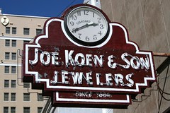 joe koen & son jewelers sign in the sun