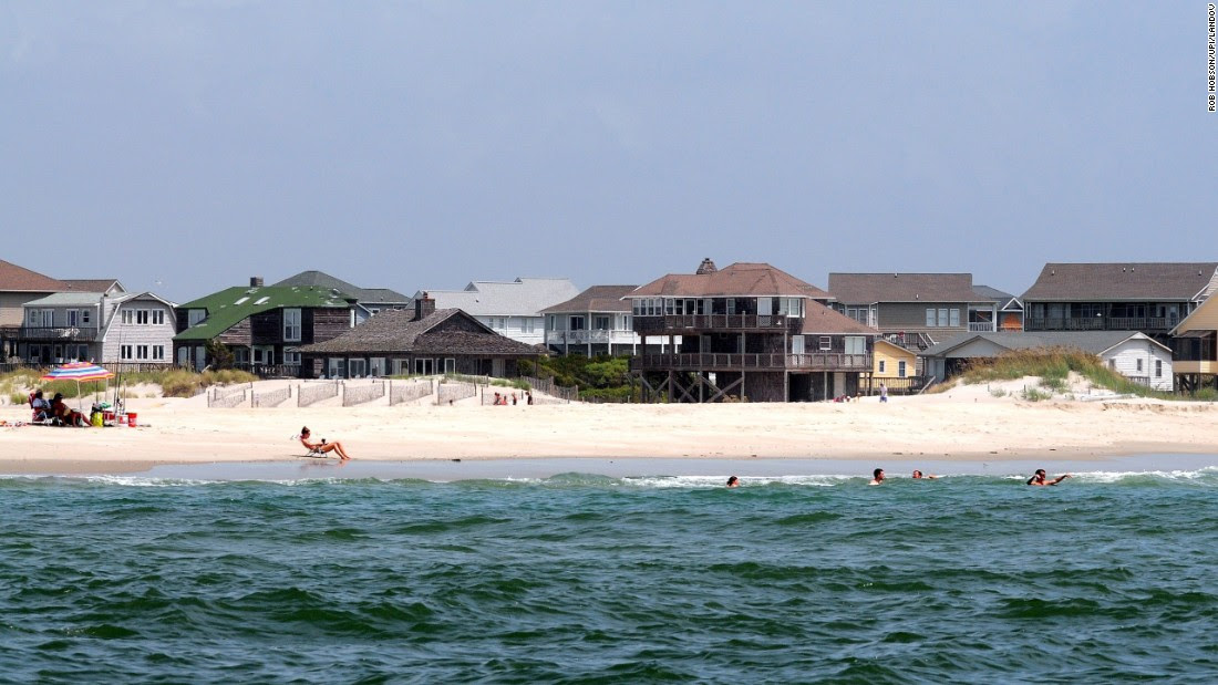 "<a href=""http://www.emeraldisle-nc.org/history.htm"" target=""_blank"">Emerald Isle</a> is located on the western half of the Bogue Banks barrier island of the Southern Outer Banks. The family-oriented beach community offers vacation rentals galore."