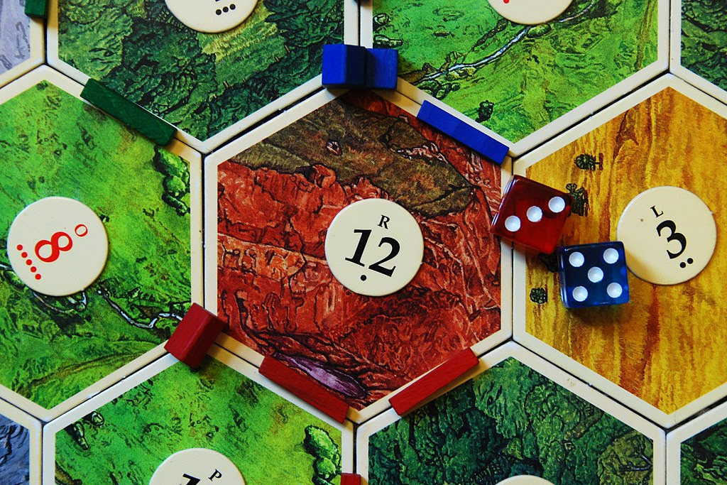 A hexagonal tile, part of a board game.