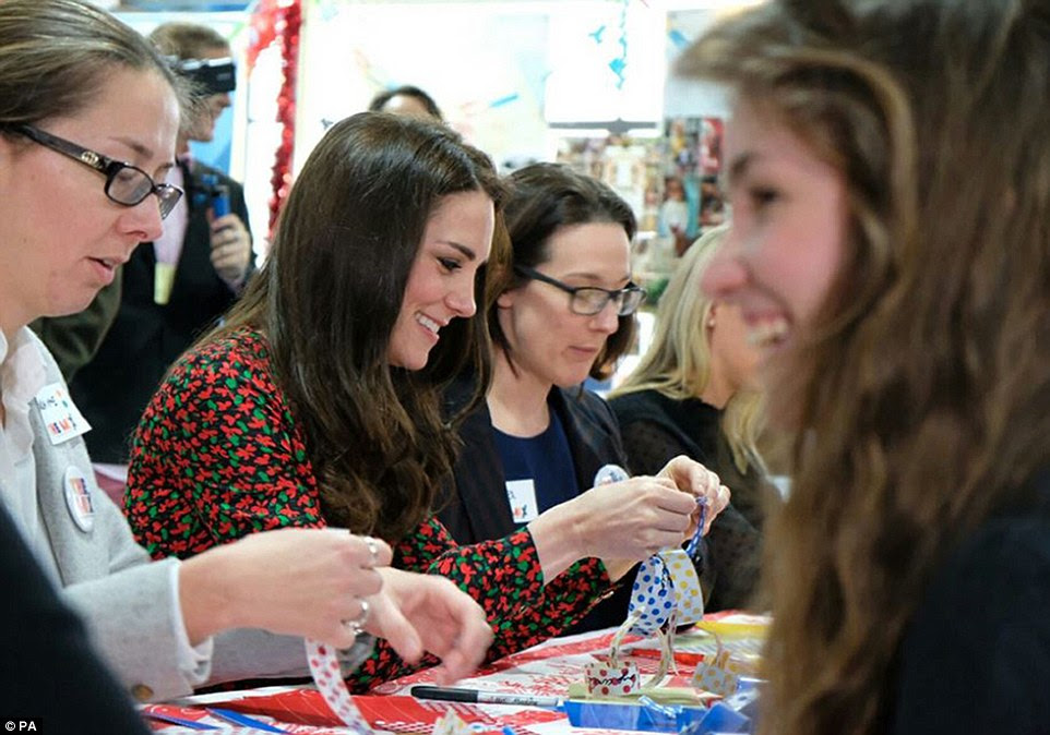 Getting crafty! Kate lends a helping hand as volunteers and serivce users make Christmas bunting