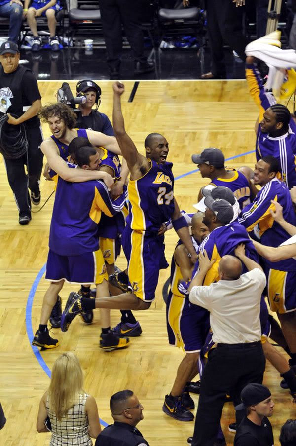The Los Angeles Lakers celebrate after defeating the Orlando Magic, 99-86, in Game 5 of the 2009 NBA Finals...winning their 15th franchise championship.