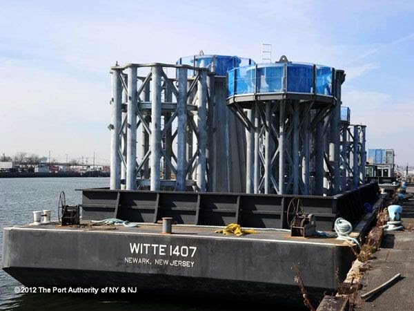 Nine sections of the antenna spire, currently located at Port Newark, await transfer to the 1 WTC's construction site in Lower Manhattan, on November 30, 2012.