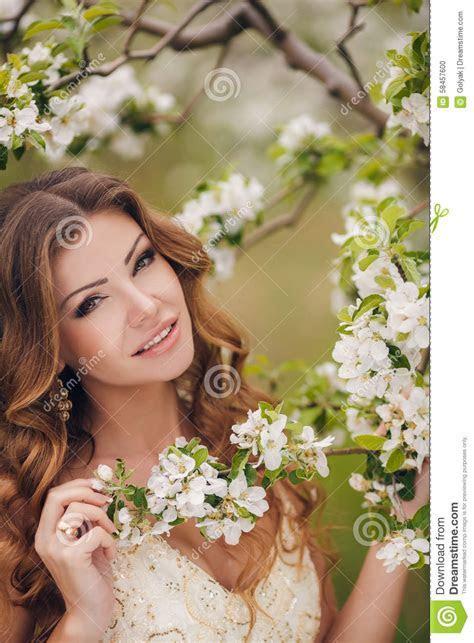 Young Beautiful Brunette Woman In Blooming Garden Stock