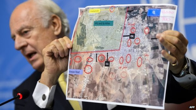 UN special envoy for Syria Staffan de Mistura shows a map of the Syrian town of Kobane during a press conference at UN office in Geneva on 10 October 2014.