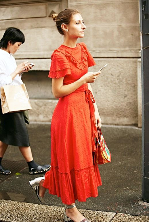 Le Fashion Blog Street Style Messy Bun Long Red Ruffled Dress Handbag Metallic Silver Heeled Shoes Via Getty Images