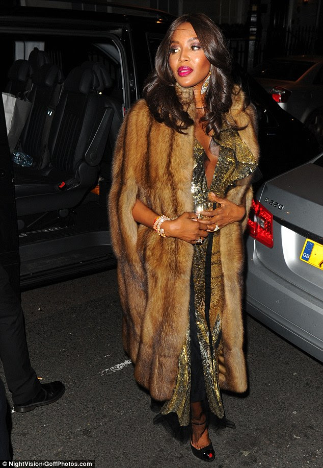 Tasteful touches:On a chilly autumn night Naomi wrapped up in a lavish faux-fur coat, while strappy peep-toe heels rounded off another memorable ensemble