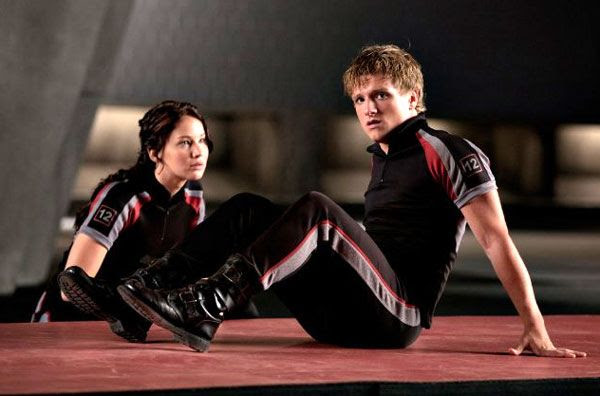 Katniss Everdeen and Peeta Mellark (Josh Hutcherson) train for THE HUNGER GAMES.