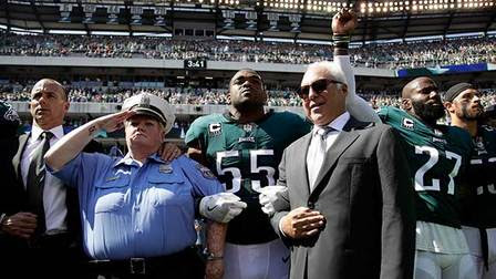 New York Giants and Philadelphia Eagles players join hands in unity before the game