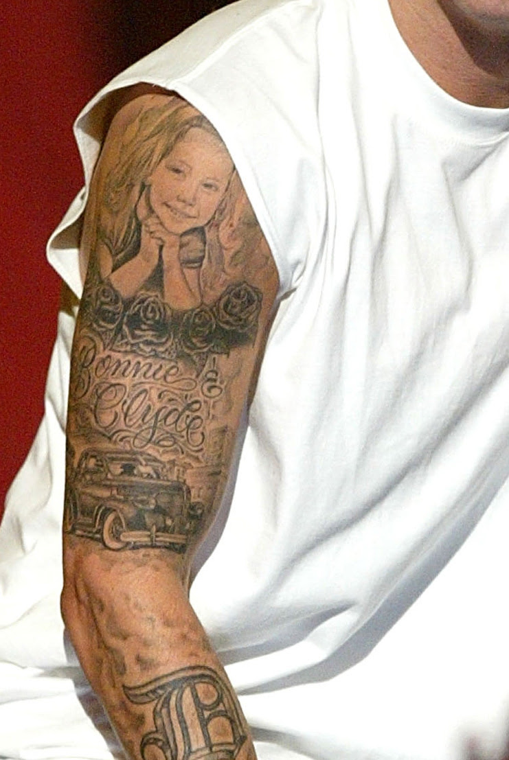Eminems Upper Sleeve Tattoo The Daughter And Bonnie And Clyde
