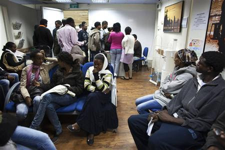 African migrants wait at a clinic which offers free health care services in Tel Aviv February 22, 2012. REUTERS-Nir Elias
