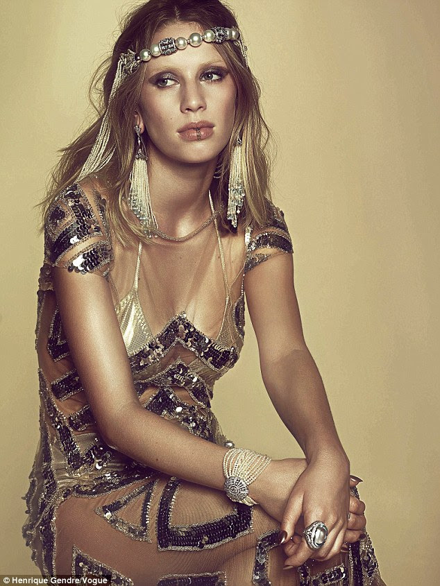 A pearl of the modeling world: In this image Dylan is draped with pearls - they are on her finger, wrist, ears and around her head
