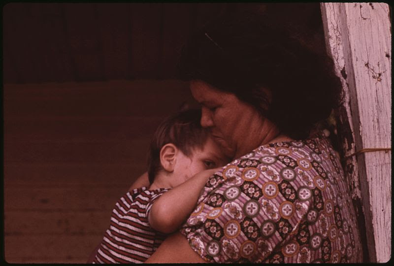 File:MRS. MAY WATKINS CUDDLES THE YOUNGEST OF HER FAMILY OF NINE ON THE FRONT PORCH OF THEIR MULKY SQUARE HOME. THIS WEST... - NARA - 553543.jpg