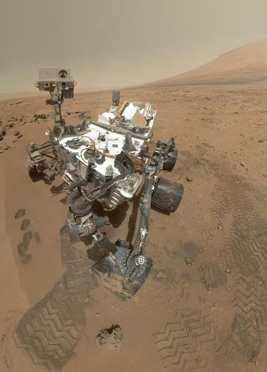 Why Don't We See the Curiosity Rover's Arm When it Takes a Selfie?